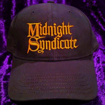 Black hat with Midnight Syndicate logo in orange embroidery